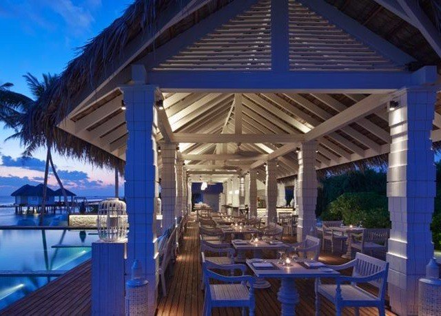 chair Resort property restaurant Dining swimming pool blue outdoor structure Villa