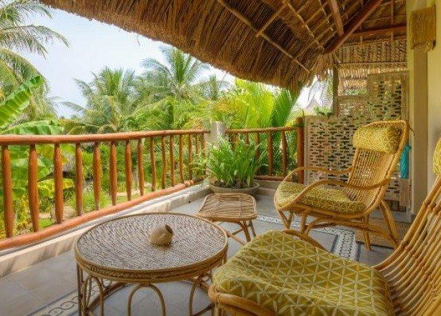 property chair Resort building Villa cottage hacienda eco hotel porch Dining condominium