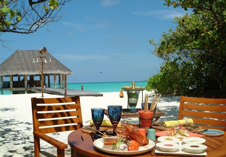 tree chair property Resort wooden home cottage caribbean Villa restaurant Dining set overlooking dining table