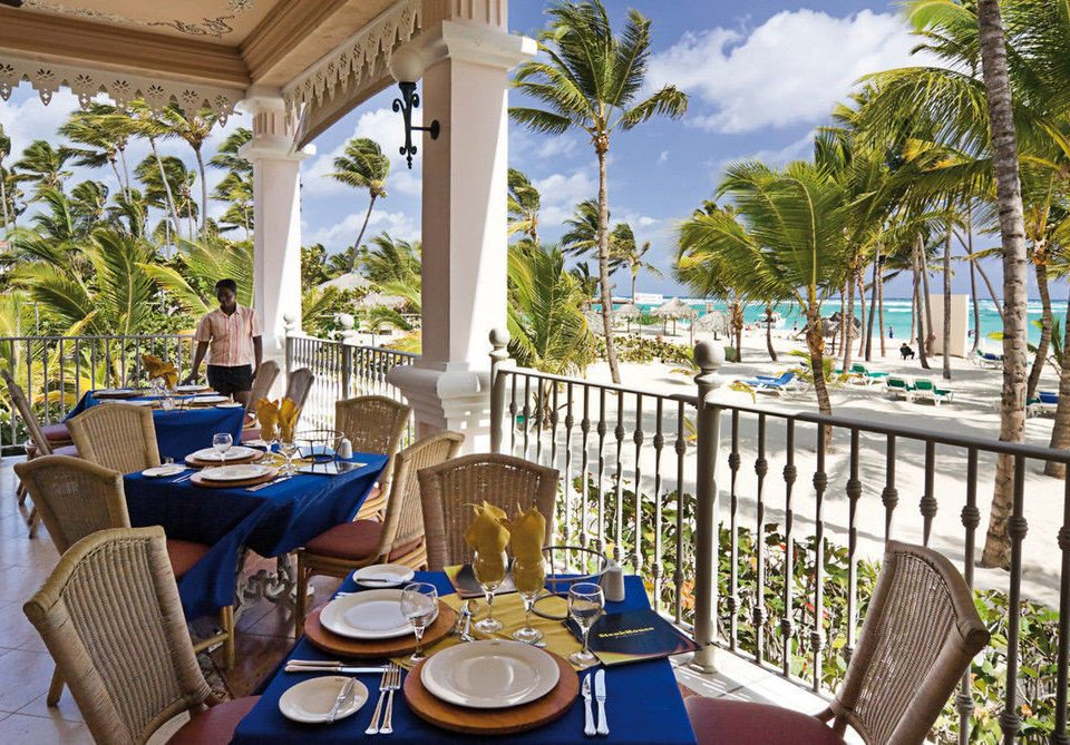 tree chair Dining leisure Resort property restaurant caribbean Villa home porch overlooking set dining table
