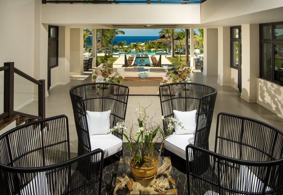 chair property home living room condominium cottage mansion porch Villa Dining farmhouse Resort dining table