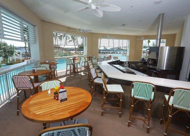 chair property Dining Resort condominium Villa dining table