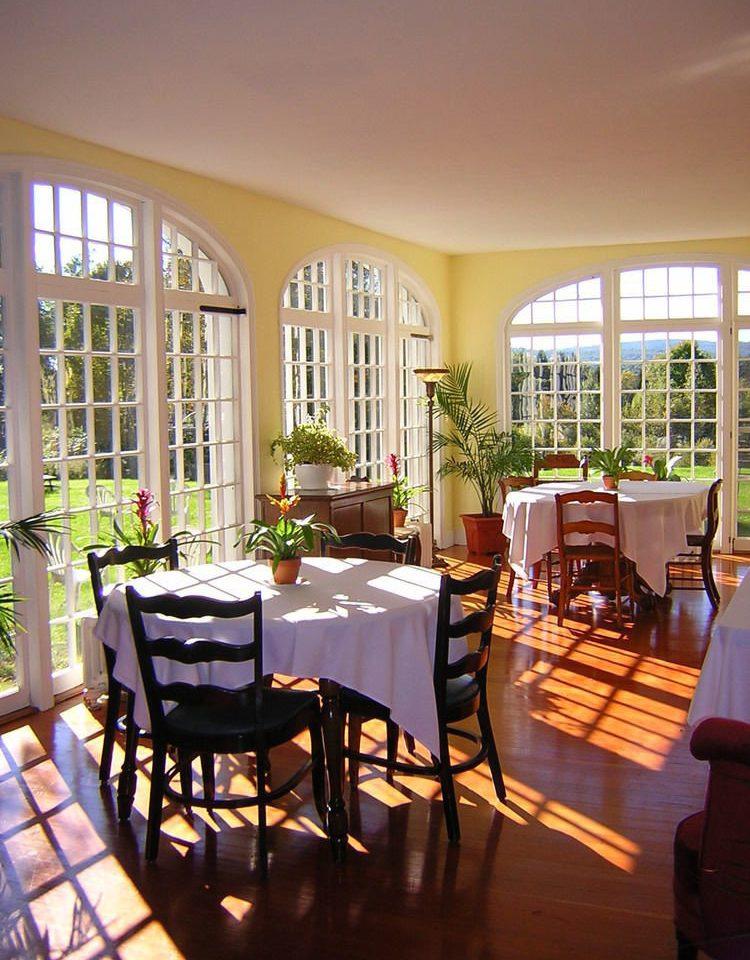 chair property home restaurant Resort Dining Villa living room dining table