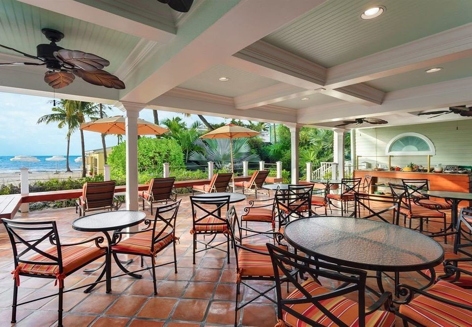 chair property Resort restaurant condominium Villa Dining function hall porch surrounded dining table