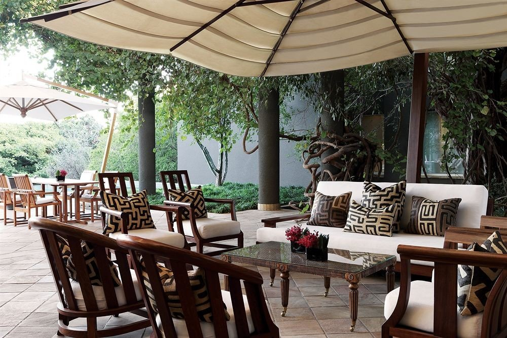tree chair property Dining restaurant Resort outdoor structure Villa set dining table