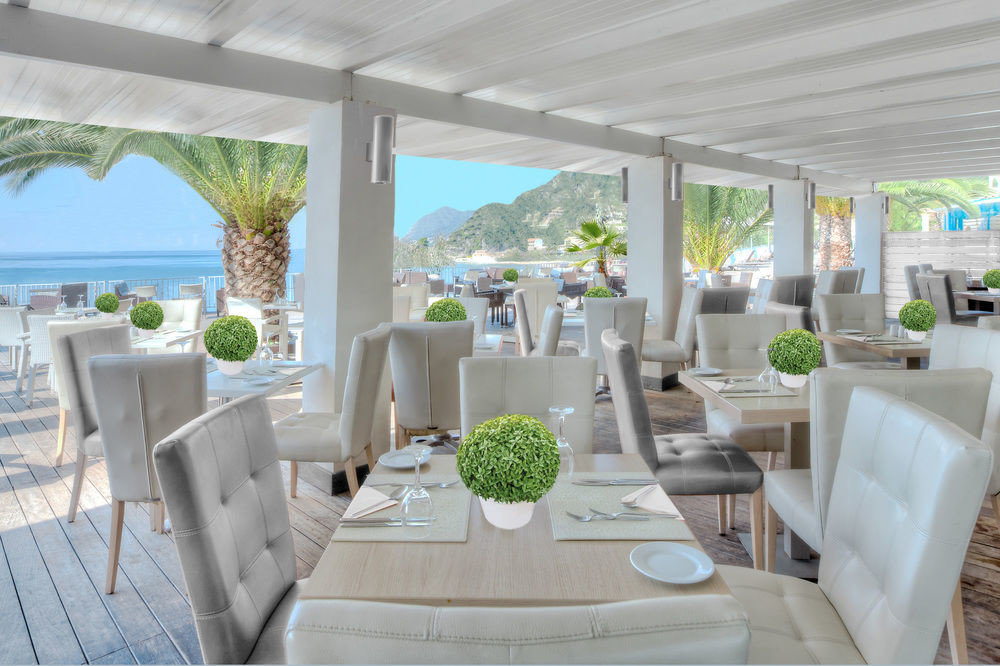 chair property living room condominium home porch Villa Resort Dining outdoor structure mansion dining table