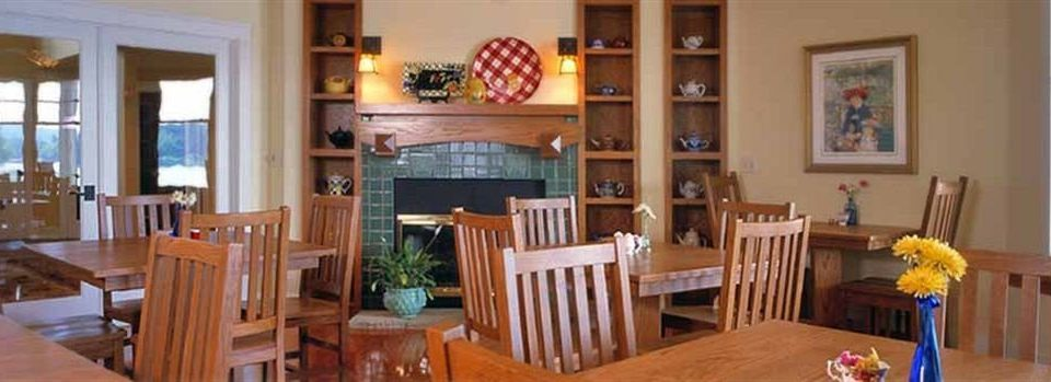 chair Dining property home wooden cottage living room hardwood Villa farmhouse Resort dining table surrounded