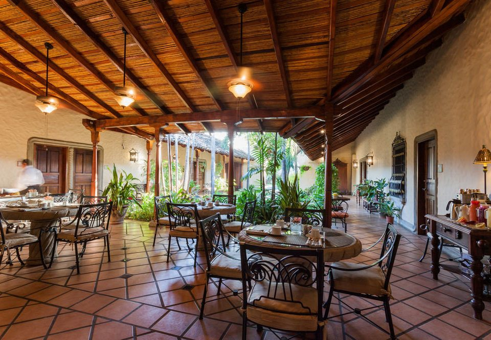 chair property Resort restaurant cottage Dining Villa farmhouse hacienda outdoor structure
