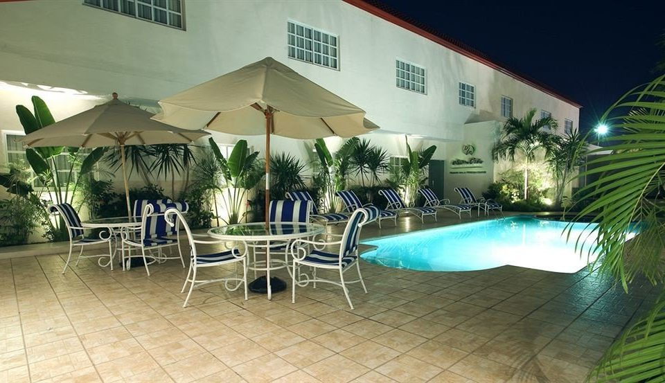 leisure property chair Resort swimming pool restaurant Villa condominium hacienda Dining