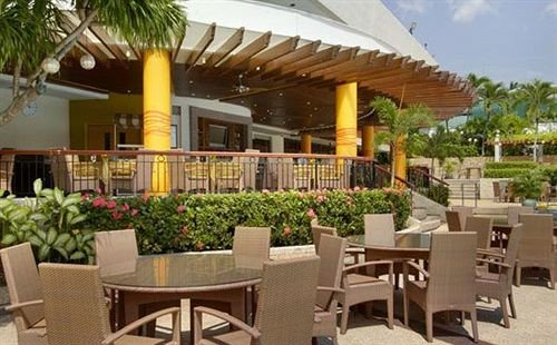 chair property Resort restaurant Dining Villa hacienda condominium eco hotel outdoor structure