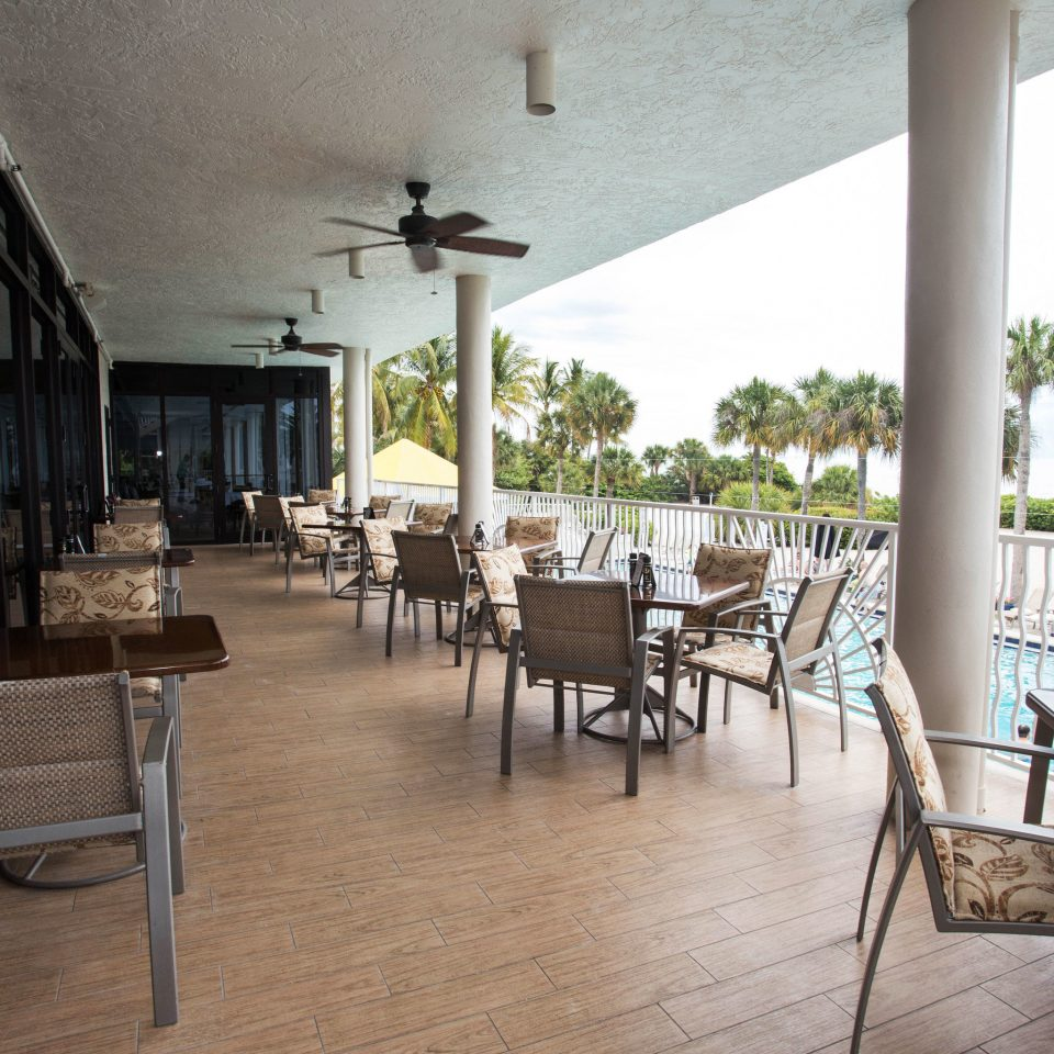 chair property restaurant porch Resort Dining Villa hacienda condominium dining table