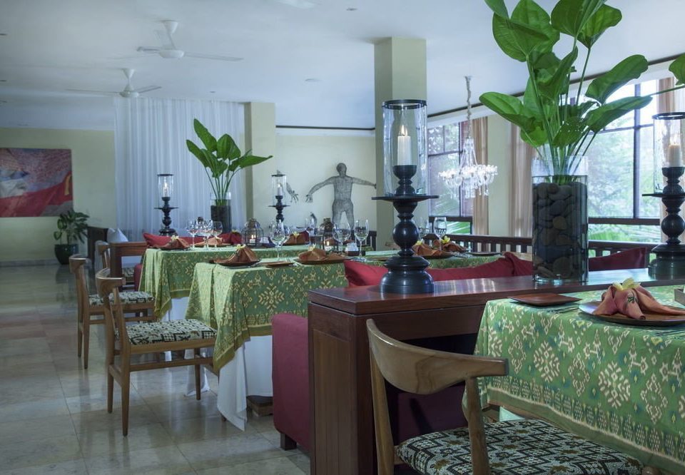 chair property restaurant condominium Dining green home hacienda Resort Villa cottage set dining table