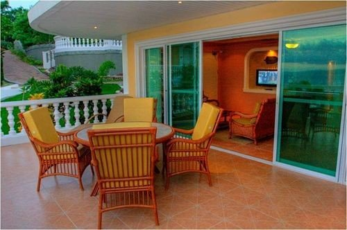 property chair condominium Villa home Dining cottage hacienda outdoor structure Resort mansion porch living room