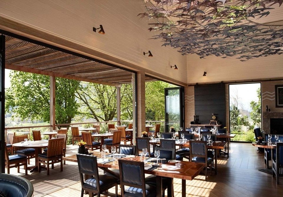 chair property Dining restaurant Resort home Villa condominium cottage porch