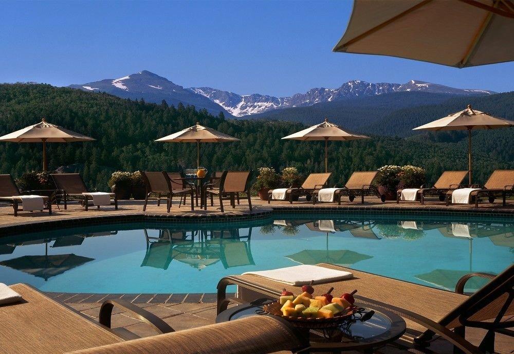 umbrella chair water mountain swimming pool property leisure Resort Villa Dining set swimming