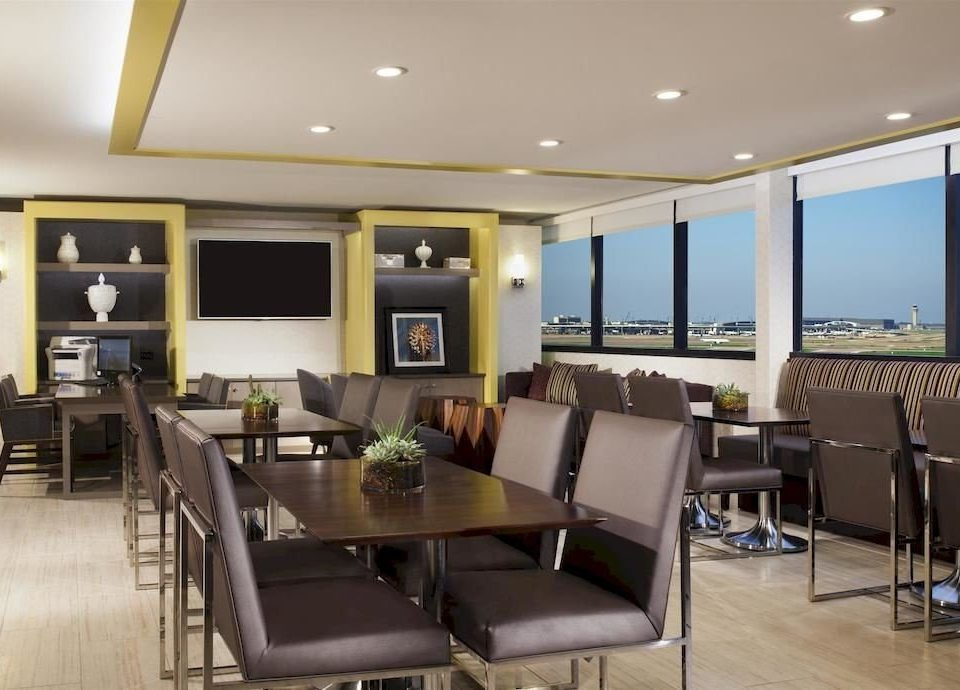 chair property condominium conference hall living room Suite Dining restaurant
