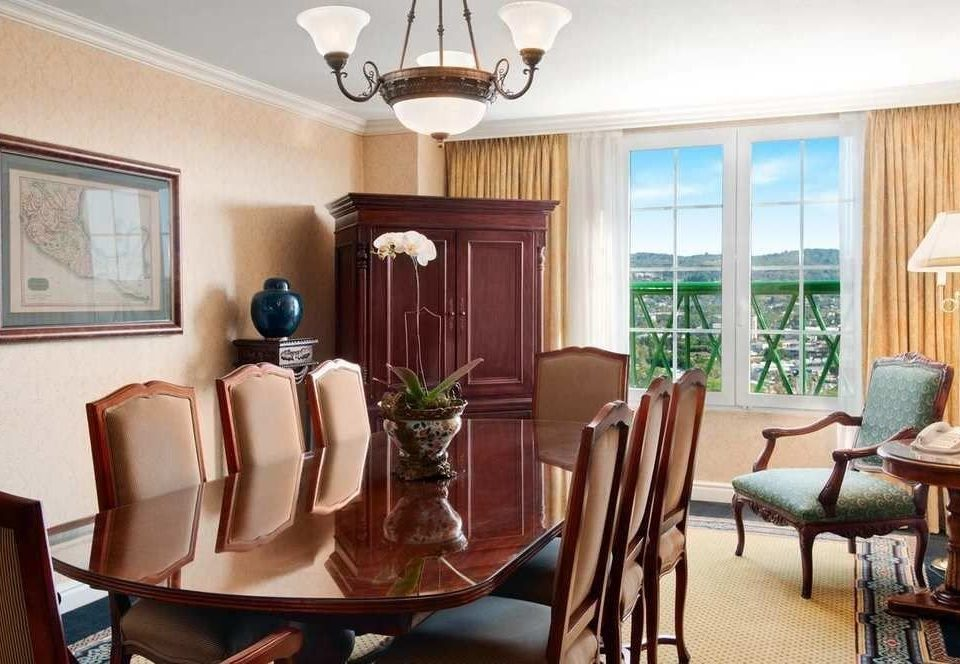 chair property home Suite condominium Dining living room cottage dining table