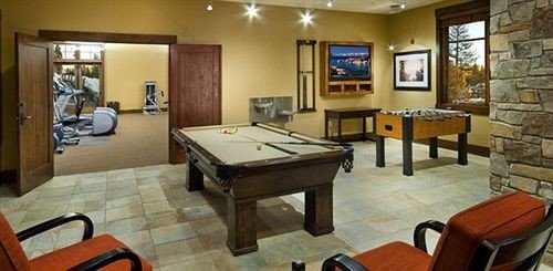 chair property recreation room building cottage living room billiard room Suite Dining Villa