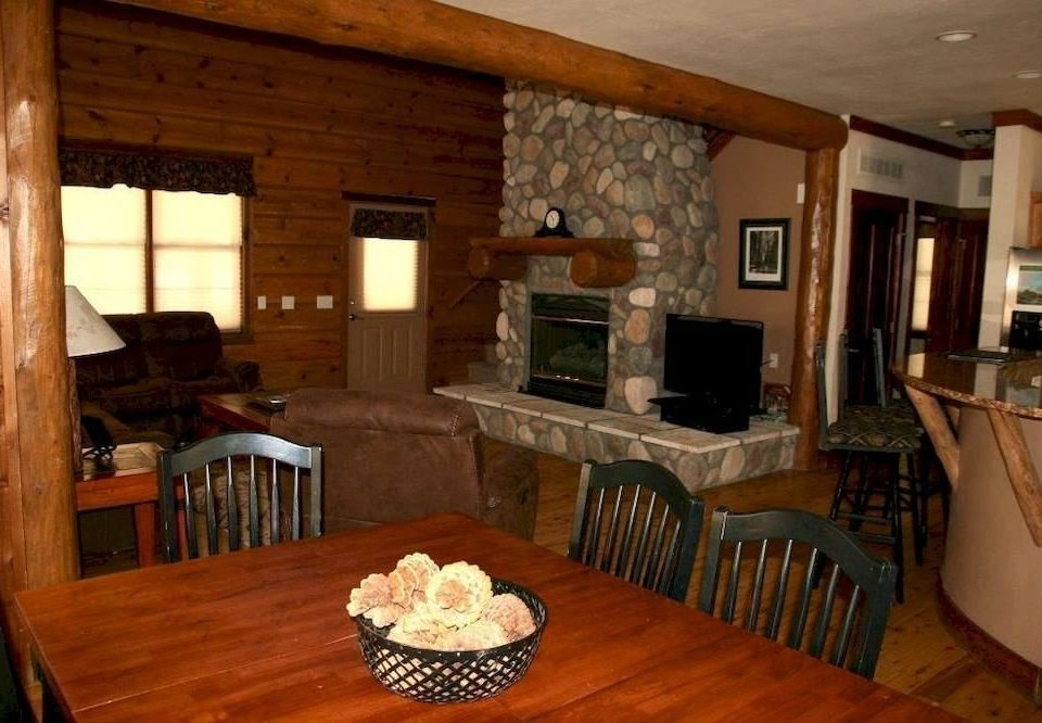 chair property Dining wooden home cottage living room hardwood Villa log cabin farmhouse mansion recreation room Suite dining table