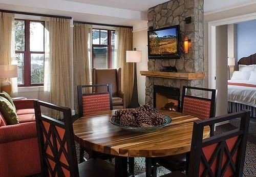 chair property living room home cottage condominium Suite Villa Dining farmhouse dining table leather