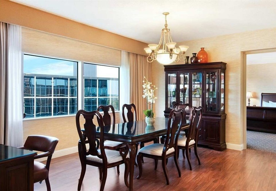 property chair living room home hardwood Dining condominium Suite cottage wood flooring Villa dining table