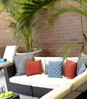 wicker living room outdoor structure plant sofa dining table