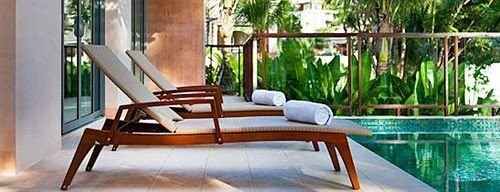 chair property hardwood home porch cottage Villa Dining swimming pool outdoor structure