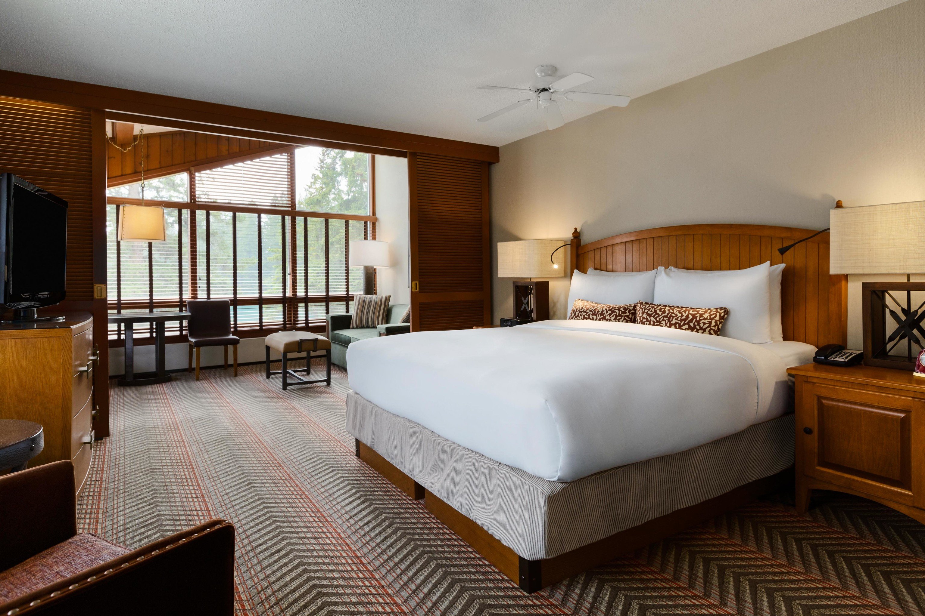 Alberta Boutique Hotels Canada Hotels indoor bed wall room floor Bedroom ceiling sofa hotel window Suite bed frame real estate interior design furniture estate boarding house mattress decorated containing several