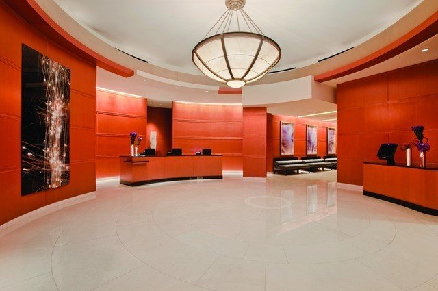 Hotels indoor floor wall ceiling property orange room Lobby interior design real estate estate living room Design dining room conference hall furniture wood hall
