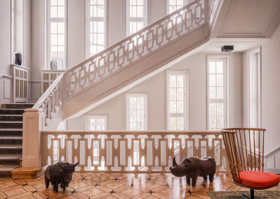 Dog chair property home house stairs hardwood baluster porch living room flooring handrail hall outdoor structure