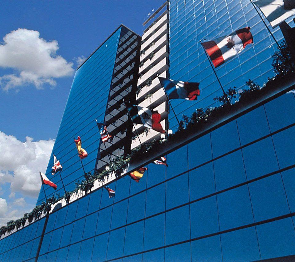 sky blue skyscraper structure tower block sport venue Downtown stadium