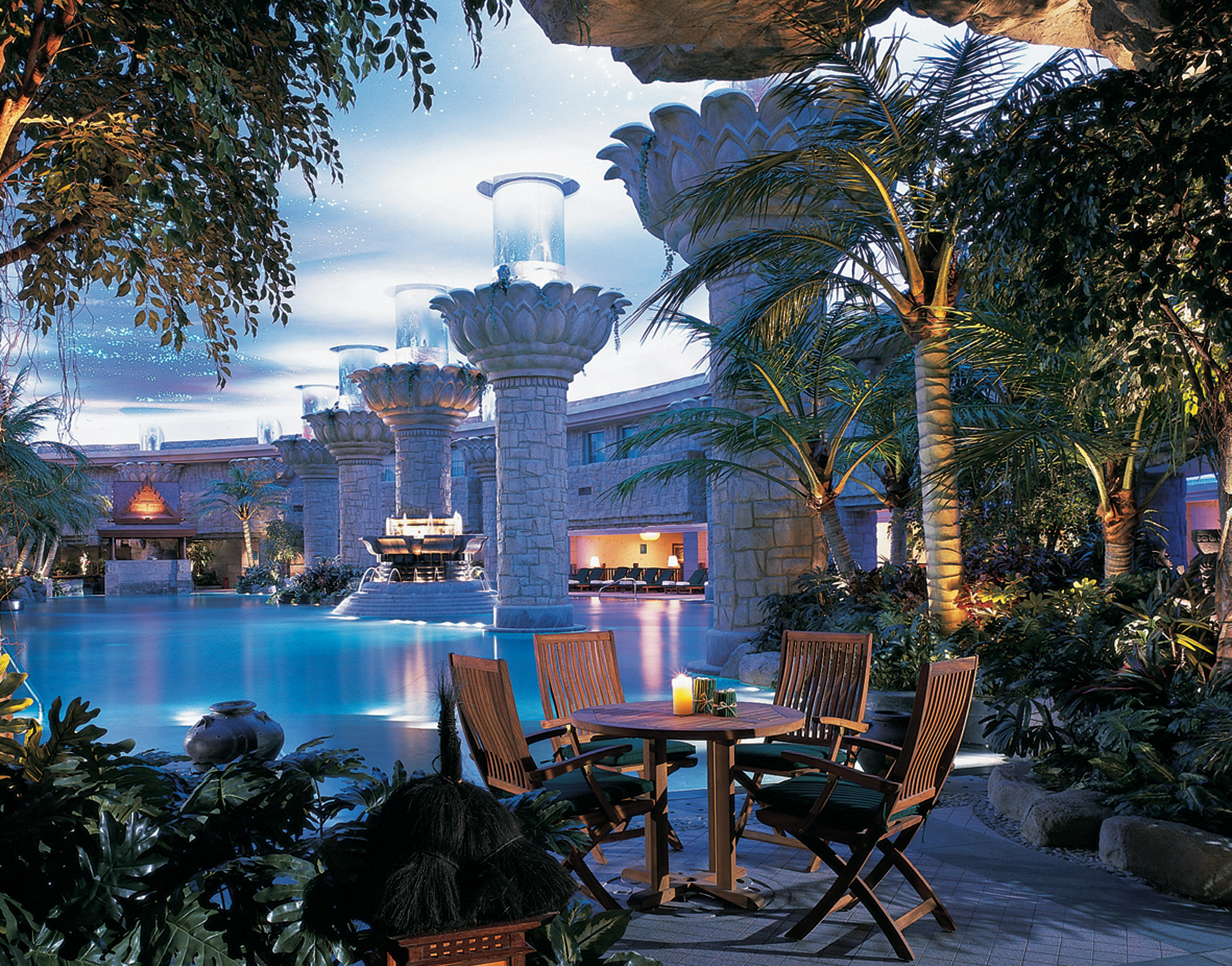 Luxury Modern Pool tree home lighting evening Downtown water feature Resort cityscape surrounded