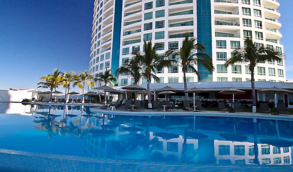 building leisure condominium blue landmark marina swimming pool Resort dock plaza Downtown tower block skyscraper