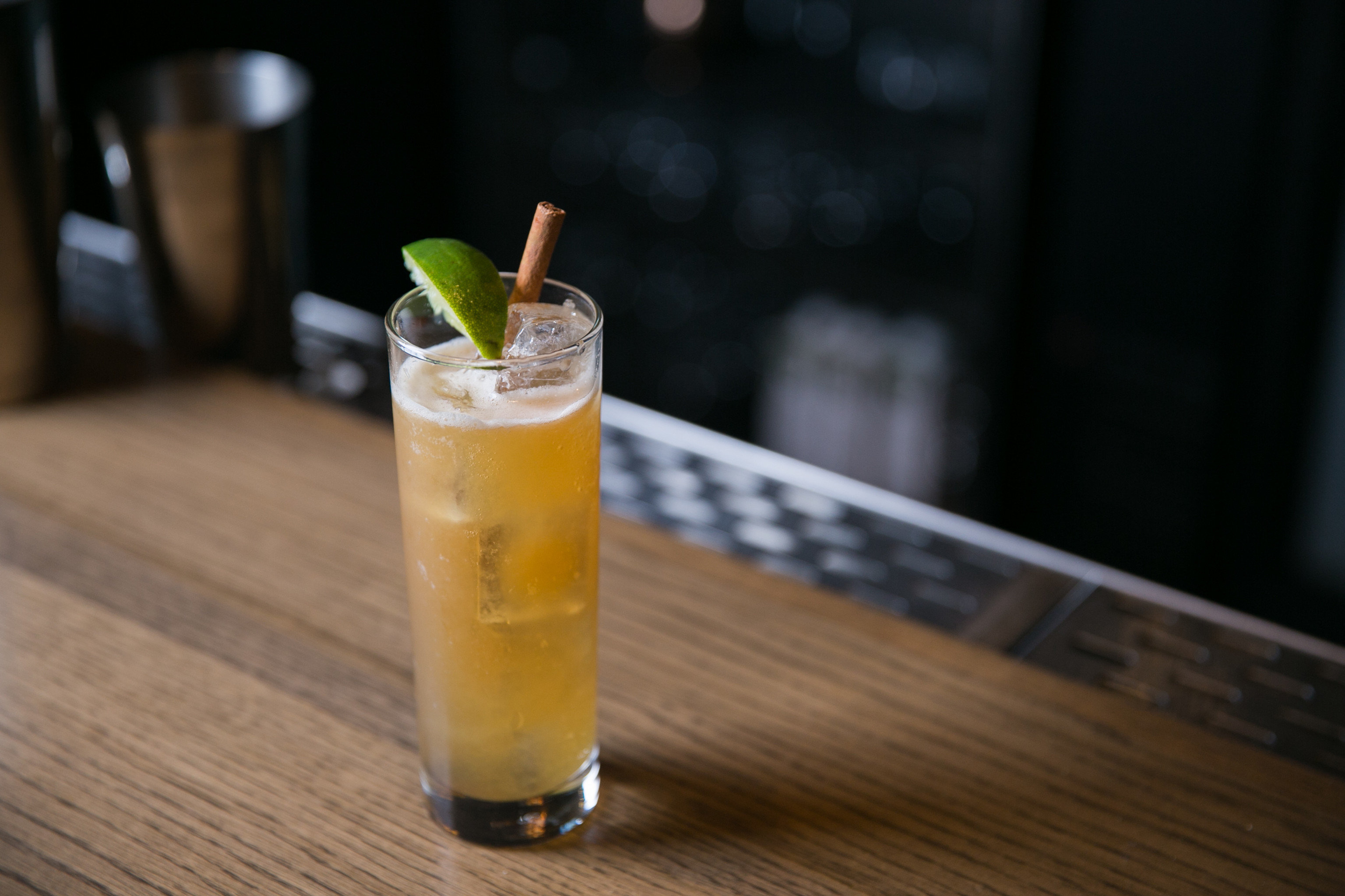 sitting Drink alcoholic beverage cocktail wooden glass food distilled beverage non alcoholic beverage liqueur beverage mai tai alcohol