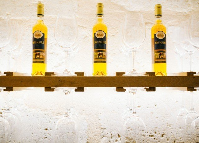 bottle yellow alcoholic beverage liqueur distilled beverage Drink wine beer