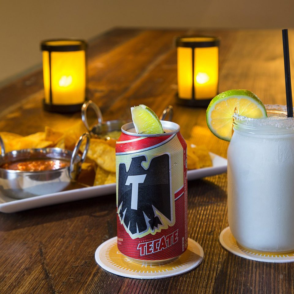 Drink yellow alcoholic beverage lighting liqueur food distilled beverage cocktail beer