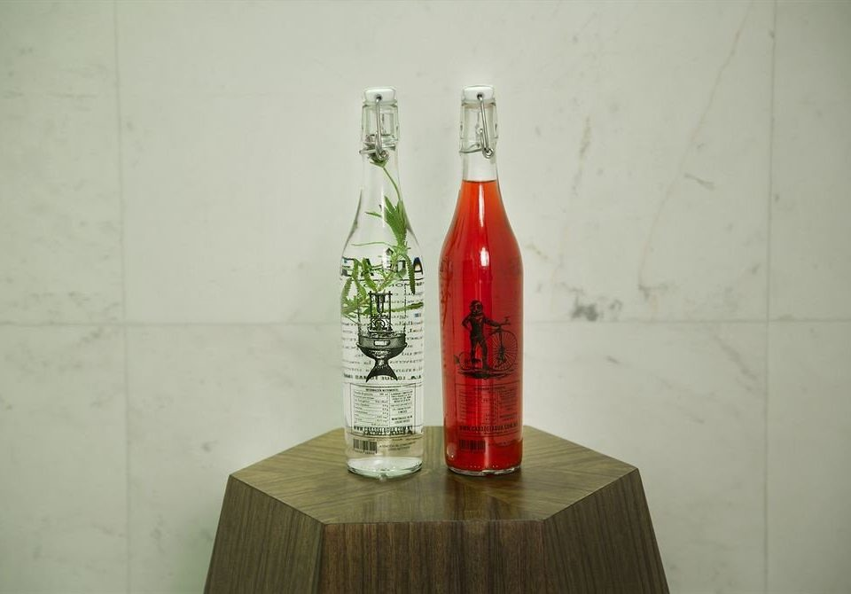 bottle man made object wine bottle distilled beverage Drink alcoholic beverage red liqueur glass bottle drinkware beverage