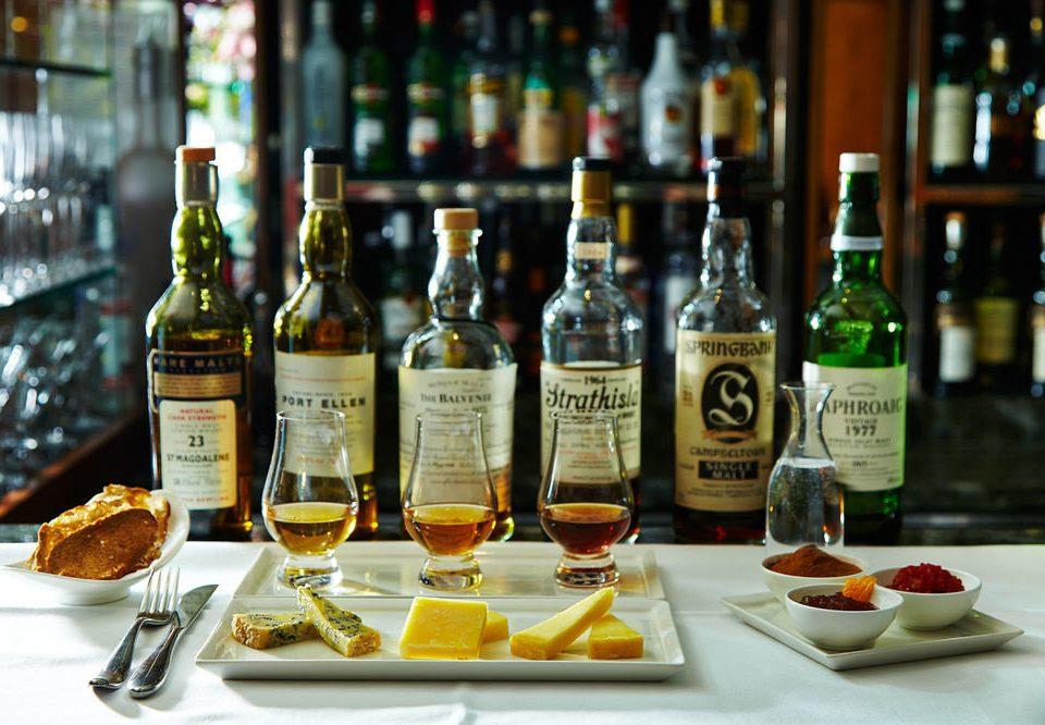 bottle wine plate alcoholic beverage distilled beverage Drink liqueur whisky