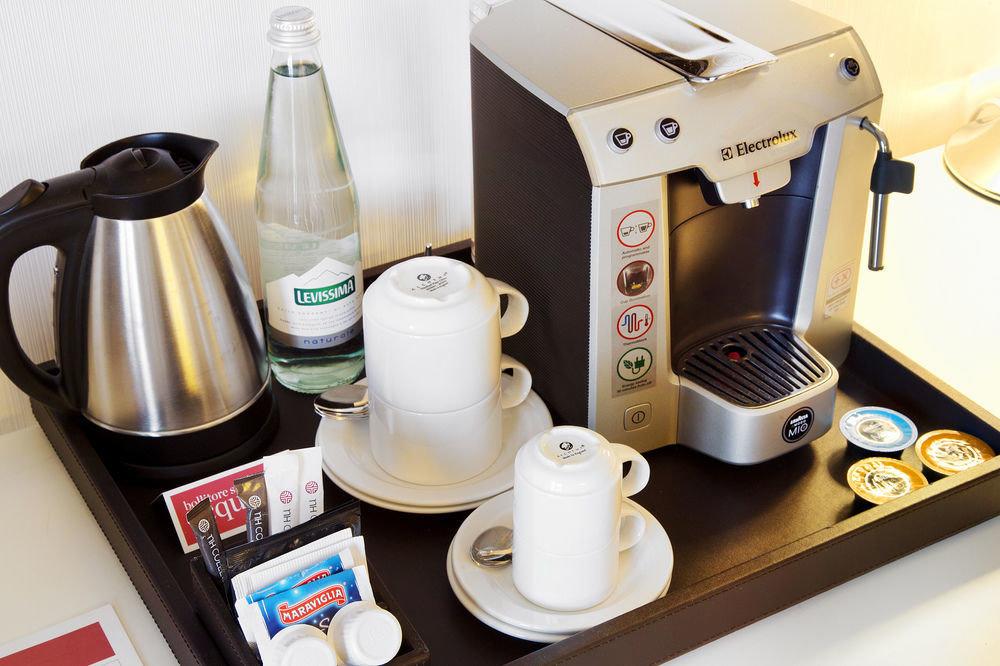 Drink desk small appliance product appliance coffee brand espresso coffee maker kitchen appliance cluttered