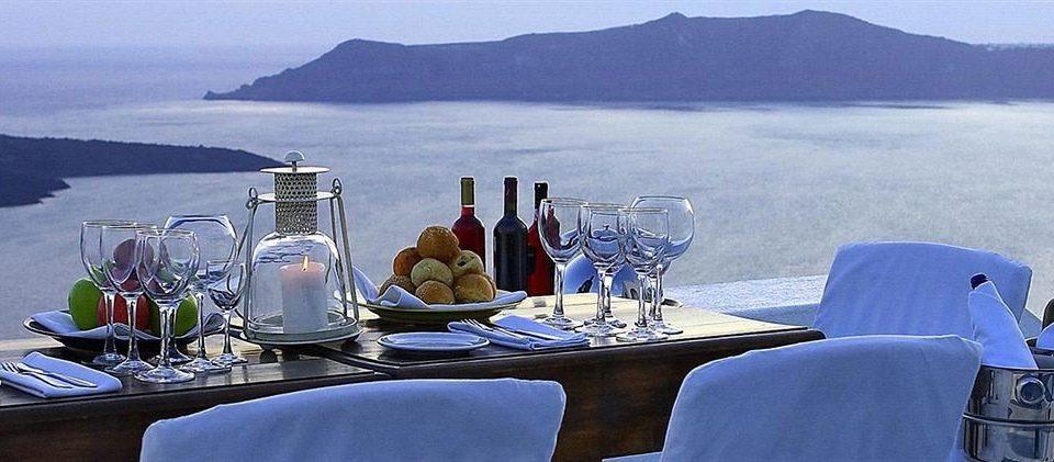 sky water mountain wine restaurant Drink overlooking drinking beer dining table
