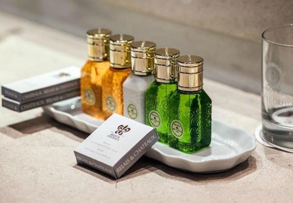 cup counter product glass bottle bottle distilled beverage brand drinkware Drink