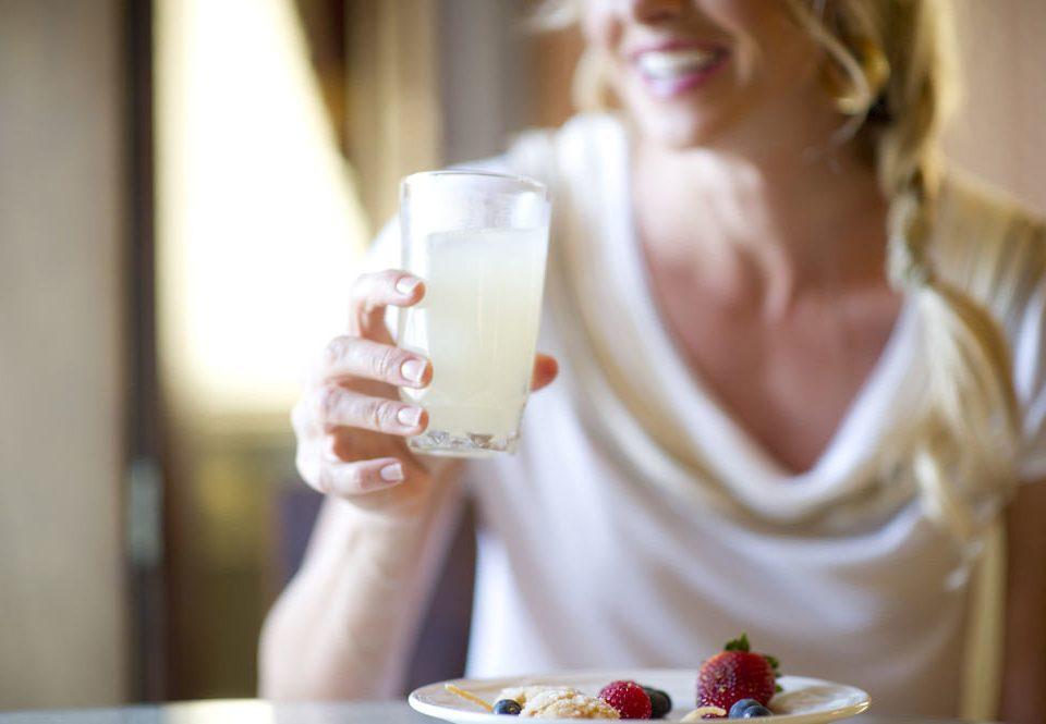 cup human action woman eating Drink food sweetness sense breakfast flavor