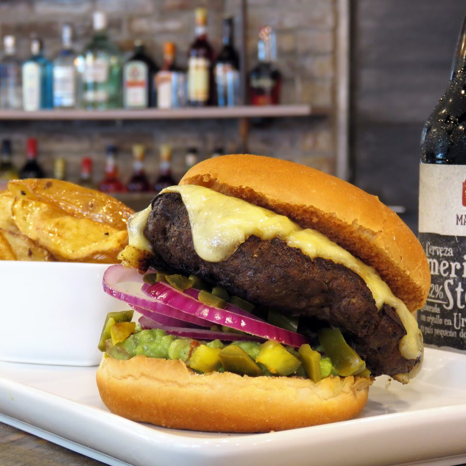 Eat food sandwich snack food bottle hamburger plate fast food lunch cheeseburger Drink meat restaurant fast food restaurant close