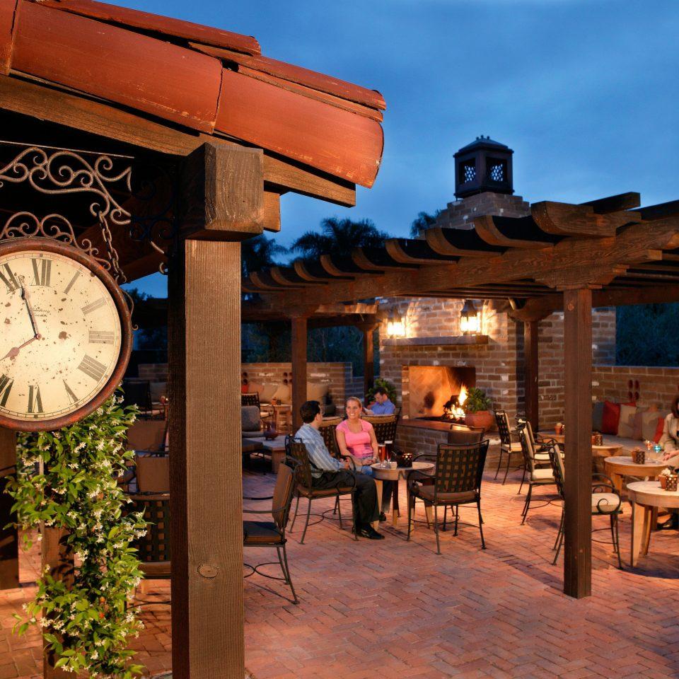 Drink Eat Exterior Patio Resort ground restaurant evening tavern travel