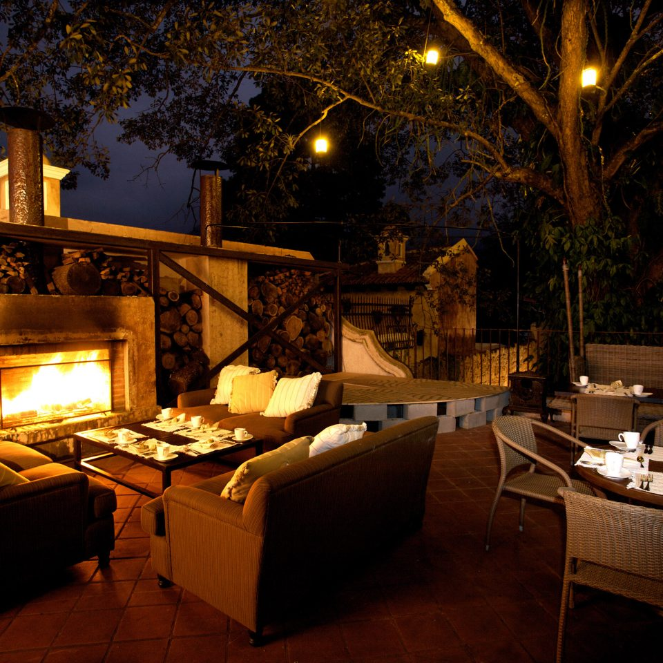 Drink Eat Fireplace Lounge Nature Outdoors Patio Romantic Rustic night restaurant home lighting lit cottage