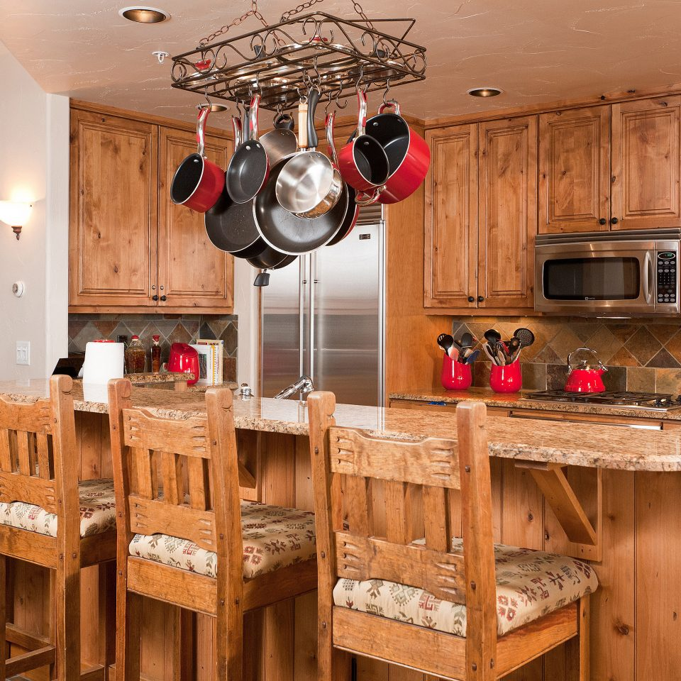 Drink Eat Kitchen cabinet wooden property cabinetry home countertop cottage appliance Island cluttered