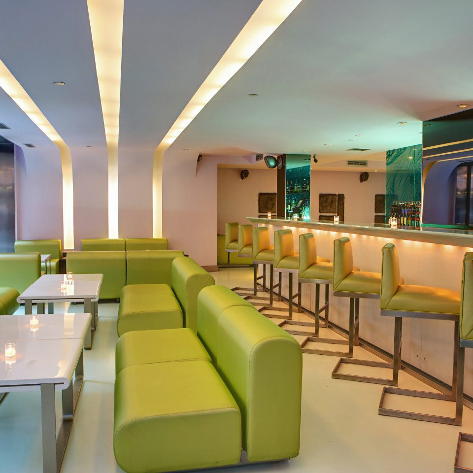 Drink Eat green chair conference hall recreation room function hall waiting room Lobby condominium convention center restaurant Resort set