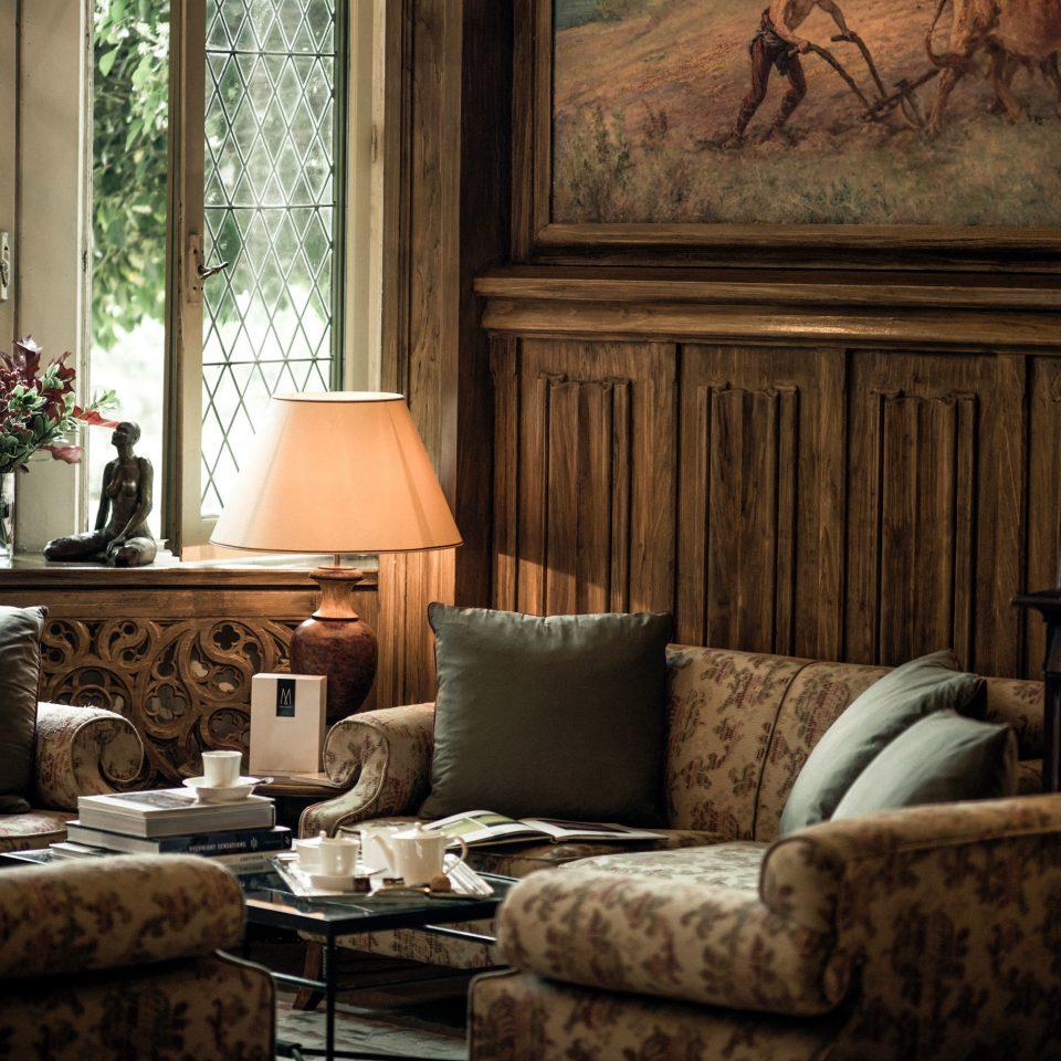 Drink Elegant Entertainment Historic Luxury sofa living room property home green cottage seat