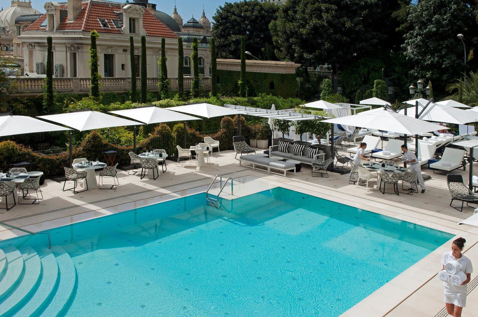 Drink Exterior Lounge Luxury Pool tree ground swimming pool leisure property Resort condominium Villa backyard swimming