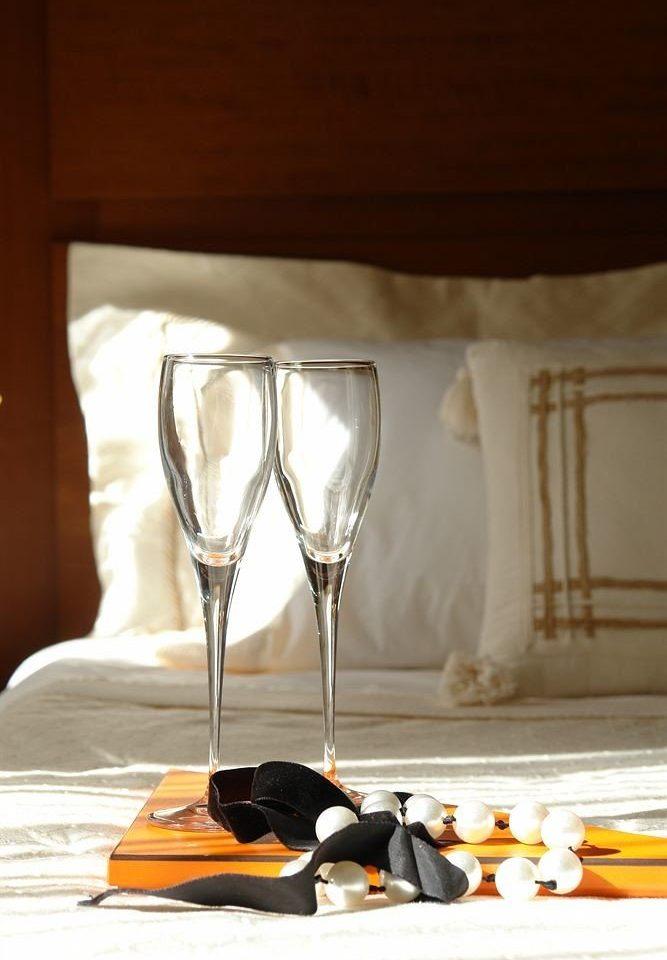 glass wine glass wine stemware lighting Drink restaurant